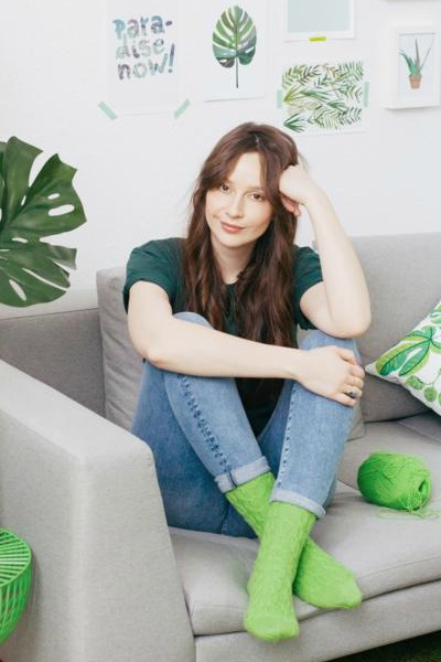 Relaxing on the sofa wearing trendy green socks